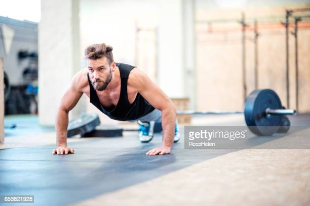 gym workout in the gym - push ups stock pictures, royalty-free photos & images