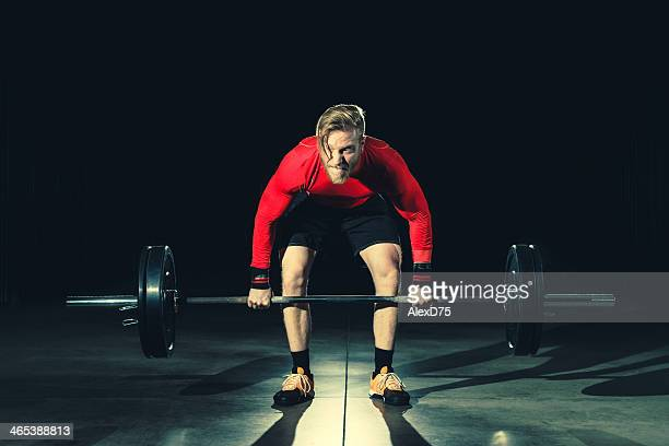 gym workout - lifting weights - snatch weightlifting stock photos and pictures