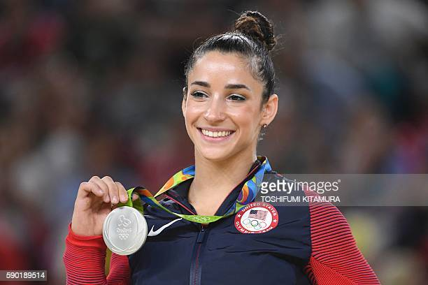 Gymnast Alexandra Raisman celebrates on the podium of the women's floor event final of the Artistic Gymnastics at the Olympic Arena during the Rio...