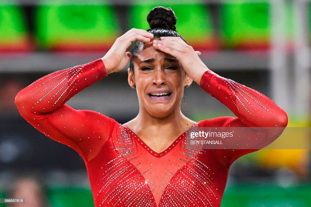 TOPSHOT - US gymnast Alexandra Raisman reacts after competing in the floor event of the women's individual all-around final of the Artistic Gymnastics at the Olympic Arena during the Rio 2016 Olympic Games in Rio de Janeiro on August 11, 2016. / AFP PHOTO / Ben STANSALL