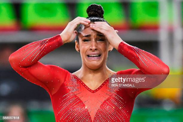TOPSHOT US gymnast Alexandra Raisman reacts after competing in the floor event of the women's individual allaround final of the Artistic Gymnastics...