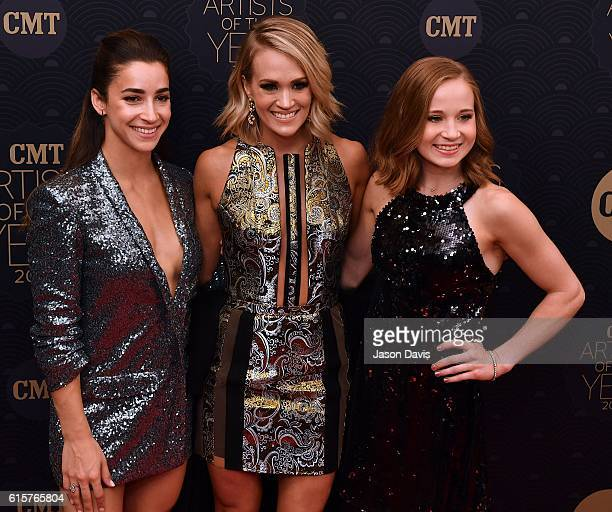 Gymnast Aly Raisman Recording Artist Carrie Underwood and Gymnast Madison Kocain arrive at 2016 CMT Artists of the Year at Schermerhorn Symphony...
