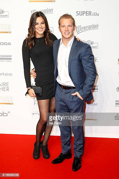 Gymnast and olympic gold medalist winner Fabian Hambuechen and his girlfriend Marcia Ev attend the Goldene Henne on October 28, 2016 in Leipzig,...
