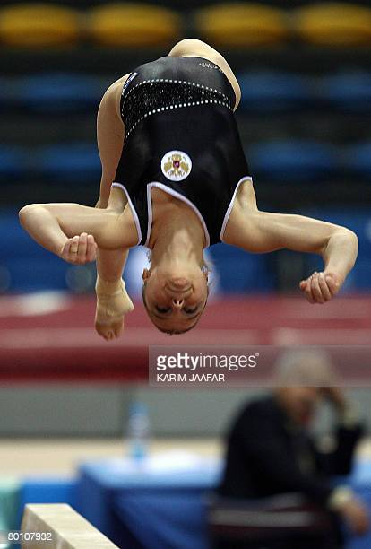 Gymnast Anna Pavlova of Russia performs on the vault during the first Doha Gymnastics World Cup at the Aspire Academy in the Qatari capital Doha on...