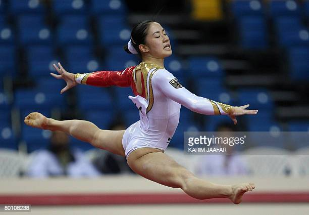 Gymnast Bui Kim of Germany performs on the floor during the first Doha Gymnastics World Cup at the Aspire Academy in the Qatari capital Doha on March...