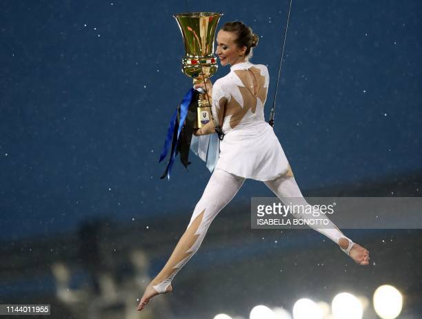 Gymnast carries the Italian Tim Cup trophy as she enters the football pitch prior to the Coppa Italia final match between Lazio and Atalanta, on May...
