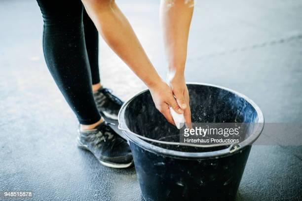 gymnast chalking up her hands - daily bucket stock pictures, royalty-free photos & images