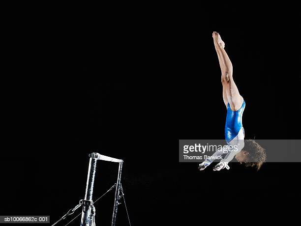 gymnast (9-10) dismounting uneven bars - horizontal bars stock pictures, royalty-free photos & images