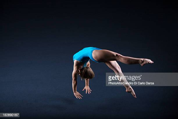 Gymnast doing back handspring