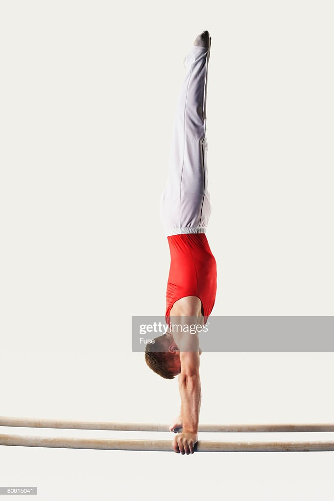 Gymnast Doing Handstand on Parallel Bars : Foto de stock