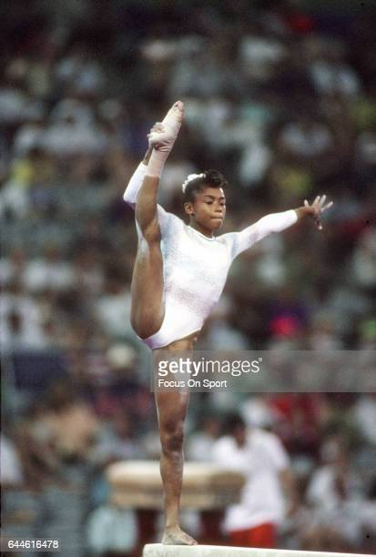 Gymnast Dominique Dawes of the United States competes on the Balance Beam during the Games of the XXV Olympiad in the 1992 Summer Olympics circa 1992...