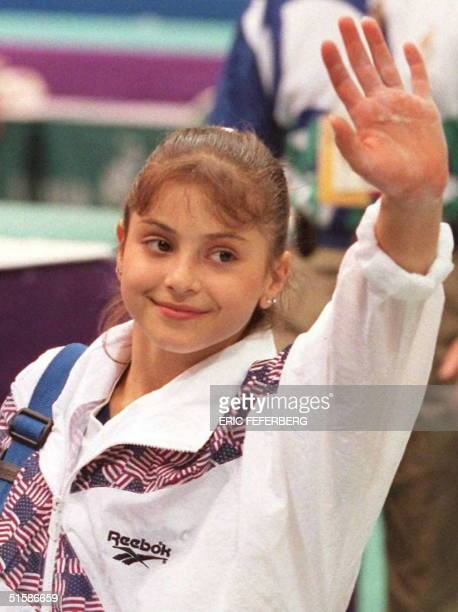 US gymnast Dominique Moceanu waves to the crowd 16 July after a practice session at Atlanta's Georgia Dome Moceanu is the youngest member of the US...