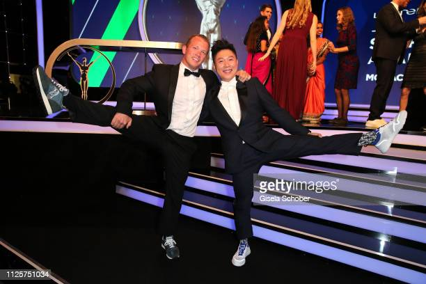 Gymnast Fabian Hambuechen and Li Xiaopeng during the Laureus World Sports Awards 2019 at Monte Carlo Sporting Club on February 18, 2019 in Monte...