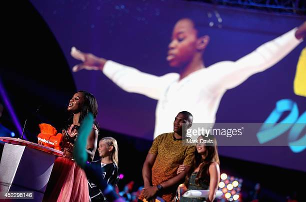 US Gymnast Gabby Douglas accepts the Best Female Athlete Award with NBA player Russell Westbrook and actress Megan Fox onstage during Nickelodeon...