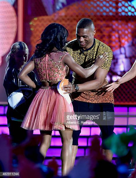 Gymnast Gabby Douglas accepts the Best Female Athlete Award with NBA player Russell Westbrook and actress Megan Fox onstage during Nickelodeon Kids'...