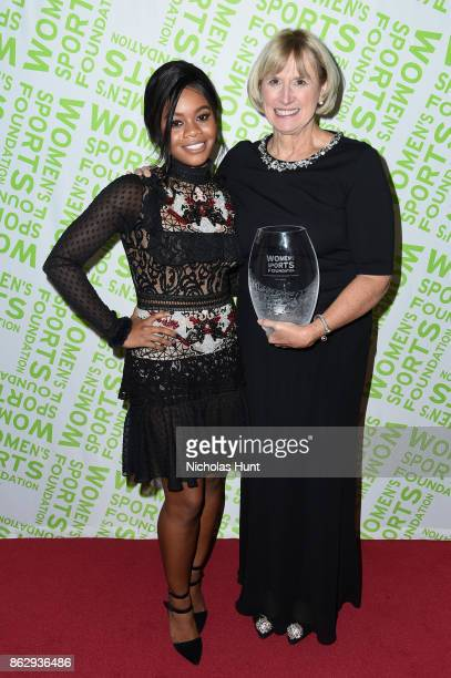 Gymnast Gabby Douglas and Mary Gen Ledecky pose with Katie Ledecky's Individual Sportswoman of the Year Award during The Women's Sports Foundation's...