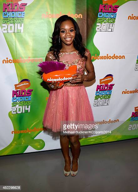 Gymnast Gabby Douglas with award for Best Female Athlete backstage at the Nickelodeon Kids' Choice Sports Awards 2014 at UCLA's Pauley Pavilion on...