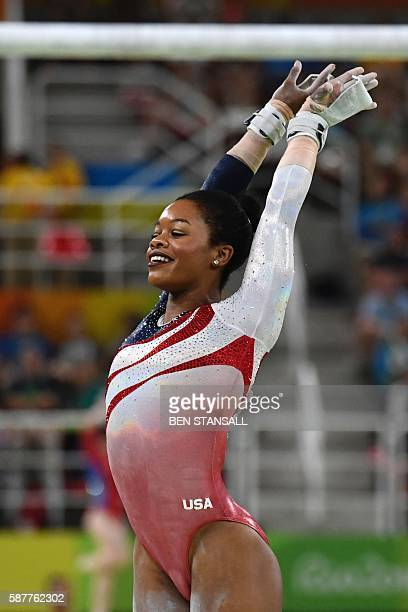 US gymnast Gabrielle Douglas competes in the Uneven Bars event during the women's team final Artistic Gymnastics at the Olympic Arena during the Rio...
