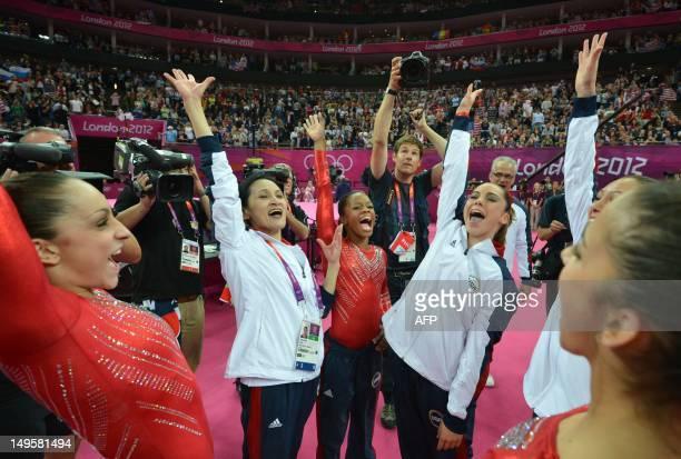 US gymnast Gabrielle Douglas Mckayla Maroney Alexandra Raisman and teammates celebrate winning gold in the women's team of the artistic gymnastics...