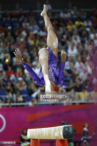 US gymnast Gabrielle Douglas performs on the beam during the women's qualification of the artistic gymnastics event of the London Olympic Games on...