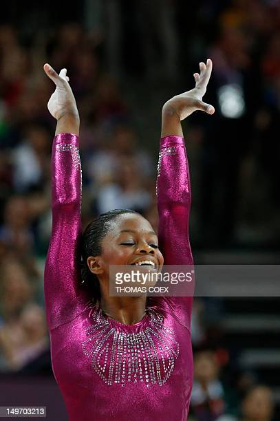 US gymnast Gabrielle Douglas performs on the floor during the artistic gymnastics women's individual allaround final at the 02 North Greenwich Arena...