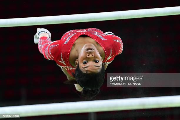 TOPSHOT US gymnast Gabrielle Douglas practices on the uneven bars of the women's Artistic gymnastics at the Olympic Arena on August 4 2016 ahead of...