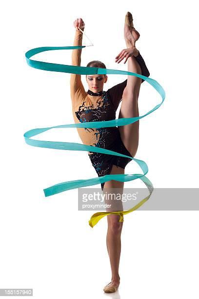 Gymnast girl does a split on white background
