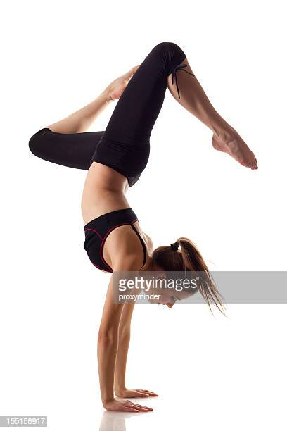 Gymnast girl isolated on white