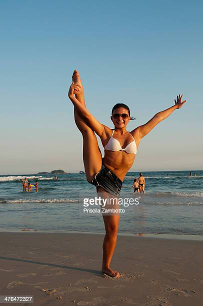Gymnast girl on the beach