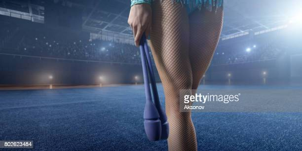 a gymnast girl stay with gymnastic maces on a large professional stage - human heart beating stock pictures, royalty-free photos & images