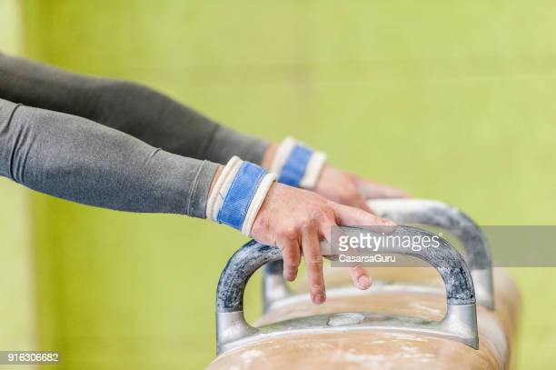 Gymnast Hands on Pommel Horse's Handles