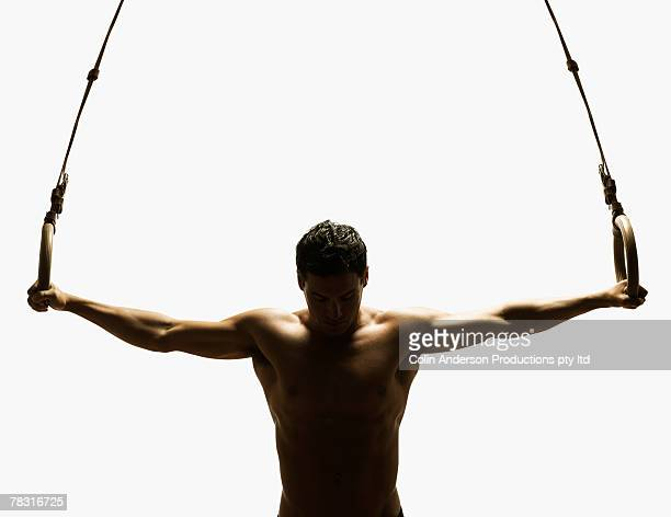 Gymnast hanging on rings