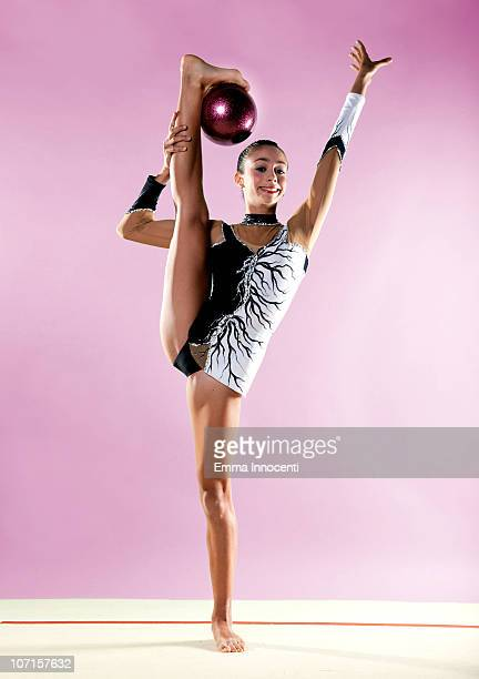 gymnast, holding ball upside down with foot
