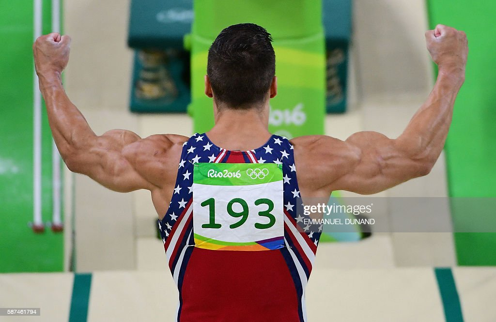 TOPSHOT - US gymnast Jacob Dalton competes in the vault of the men's team final of the Artistic Gymnastics at the Olympic Arena during the Rio 2016 Olympic Games in Rio de Janeiro on August 8, 2016. / AFP / Emmanuel DUNAND