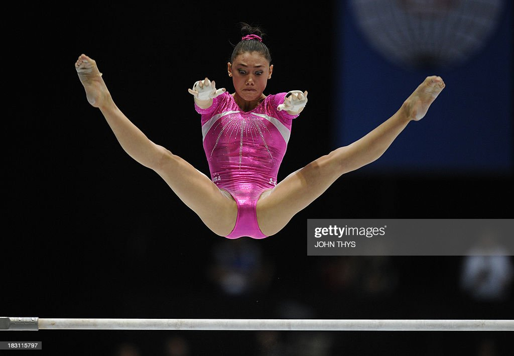 Us Gymnast Kyla Ross Performs On The Uneven Bars During