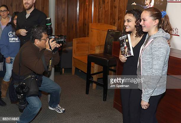 """Gymnast Laurie Hernandez with a fan for her new book """"I Got This"""" at Bookends Bookstore on January 22, 2017 in Ridgewood, New Jersey."""