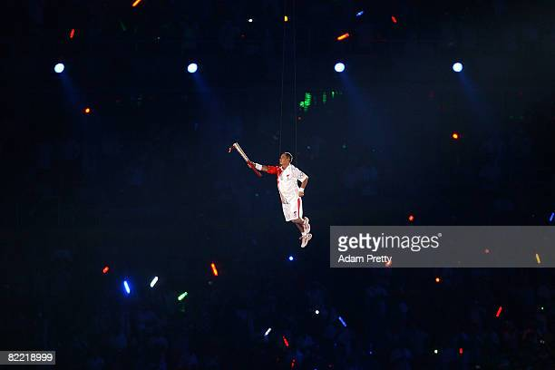 Gymnast Li Ning carries the Olympic Torch during the Opening Ceremony for the 2008 Beijing Summer Olympics at the National Stadium on August 8 2008...