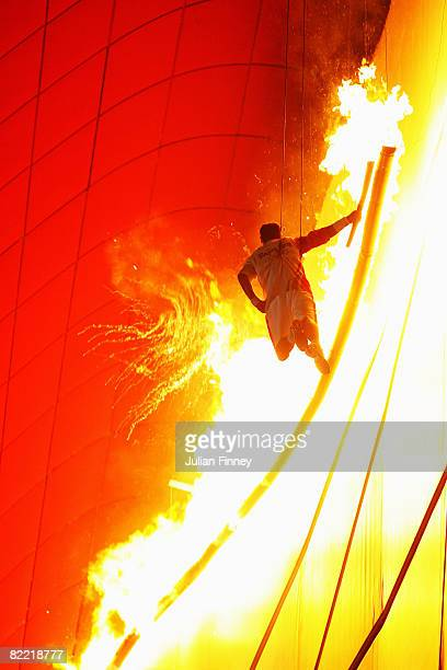 Gymnast Li Ning lights the Olympic Flame during the Opening Ceremony for the 2008 Beijing Summer Olympics at the National Stadium on August 8 2008 in...