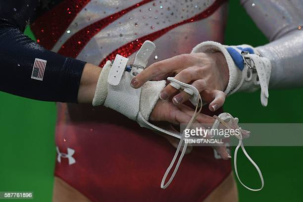 TOPSHOT US gymnast Madison Kocian prepares to compete in the Uneven Bars event during the women's team final Artistic Gymnastics at the Olympic Arena...