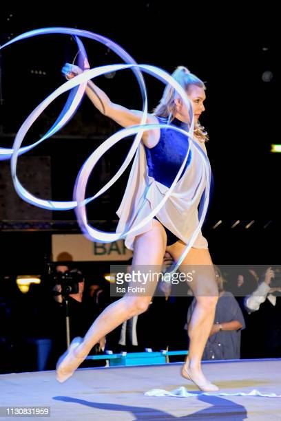 Gymnast Magdalena Brzeska performs during the presentation of the collection VIGOUR vogue by designer Brian Rennie at arena Berlin on February 19,...