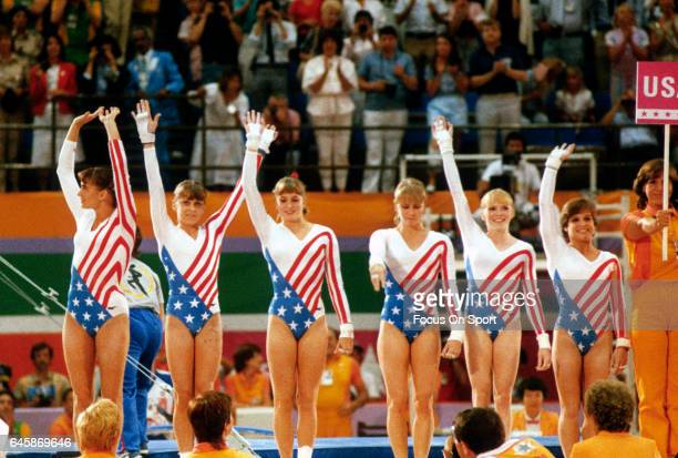 Gymnast Mary Lou Retton of the United States on the waves to the fans with her teammates during competition in gymnastics of the Games of the XXIII...