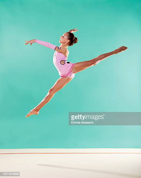 gymnast,  mid air, split, pink leotard - girl with legs spread stock photos and pictures