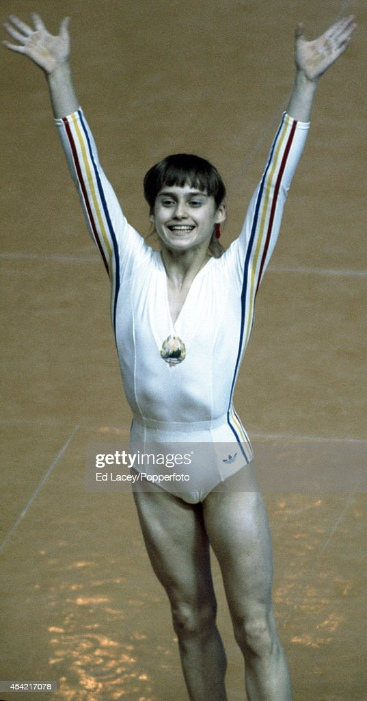 Gymnast Nadia Comaneci of Romania acknowledges the crowd after her gymnastics performance during the Summer Olympics Games in Montreal on 21st July 1976. She won a total of three gold medals - and two more during the 1980 Moscow Olympic Games.