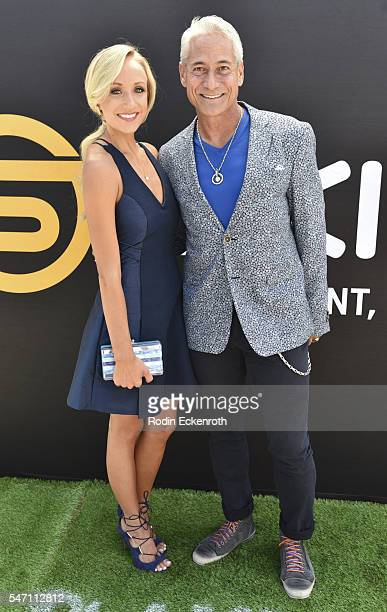 Gymnast Nastia Liukin poses and Olympic Gold Medalist Greg Louganis attend Greg Louganis' Pre-ESPY Awards Wheaties Breakfast for Champions at The...