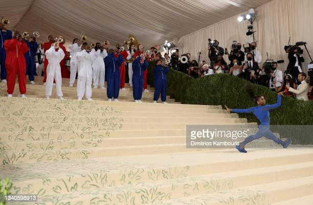 Gymnast Nia Dennis and The Brooklyn United Marching Band perform at The 2021 Met Gala Celebrating In America: A Lexicon Of Fashion at Metropolitan...
