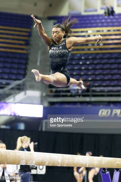 UCLA gymnast Nia Dennis performs her routine on the balance beam during a women's college gymnastics meet between the UCLA Bruins and the Washington...