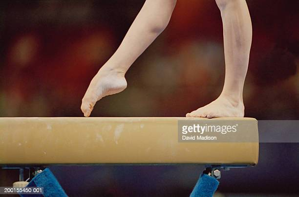 gymnast on balance beam, low section, close-up - gymnastics stock pictures, royalty-free photos & images