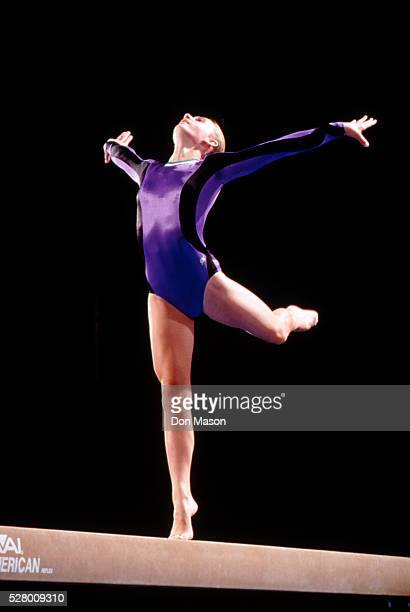 gymnast on balance beam - balance beam stock pictures, royalty-free photos & images