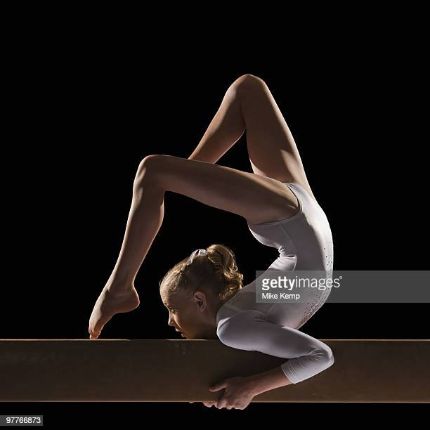 gymnast on balance beam - little girls doing gymnastics stock photos and pictures