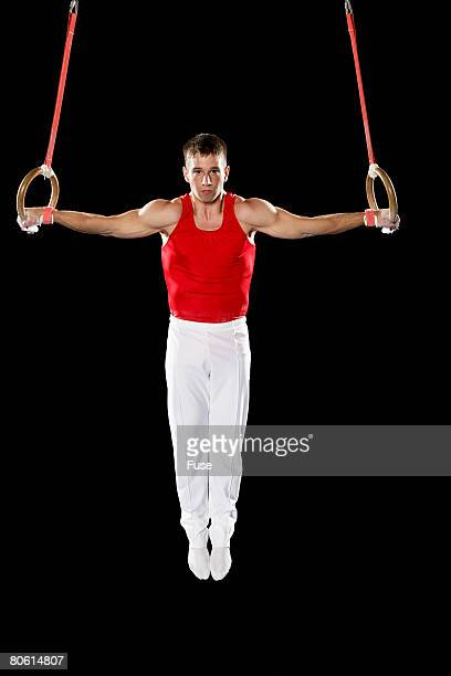 Gymnast on Stationary Rings